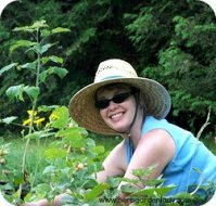 That's me in my raspberry patch weeding and mulching with composted chicken manure.